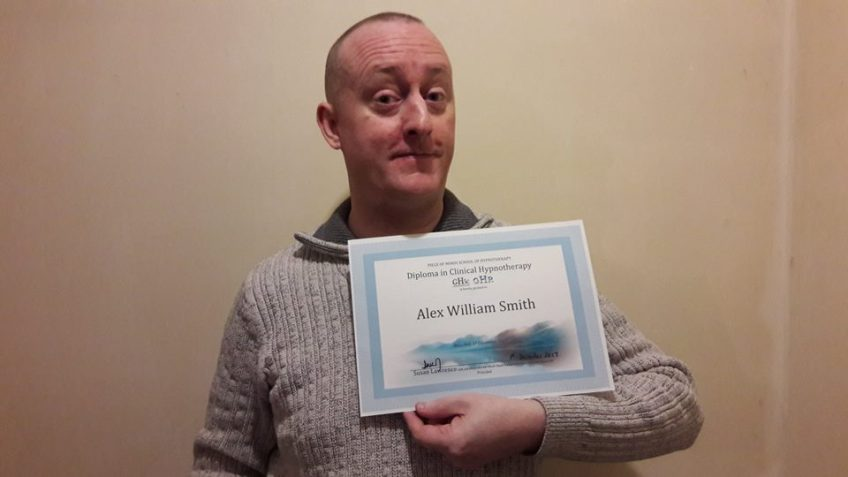 Alex Smith Proudly Holding his Professional Clinical Hypnotherapy Diploma from Susan Lawrence which is GHR & GHSC Endorsed.
