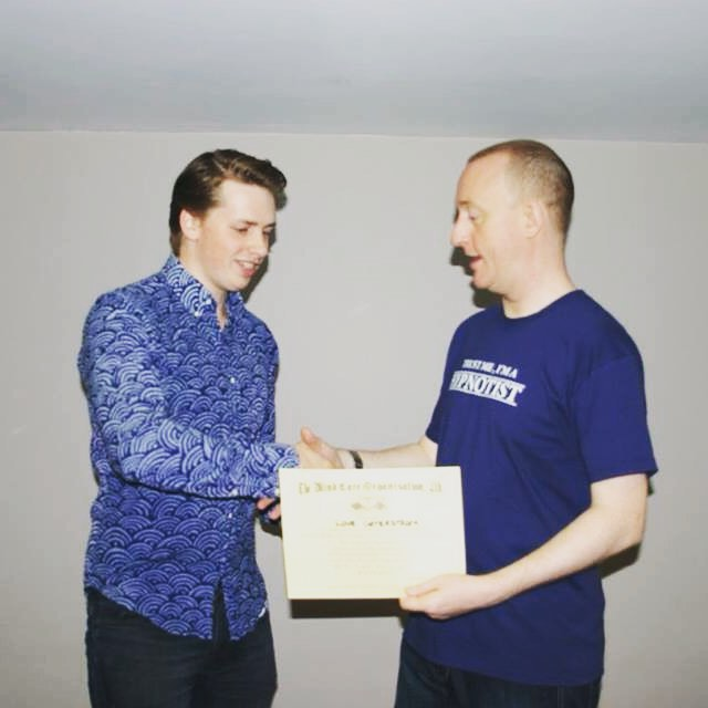 Love Örterström Swedish Magician & Hypnose Hypnotist being awarded diploma by Jonathan Royle